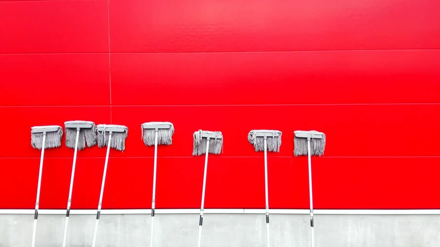 Cleaning supplies and a red wall