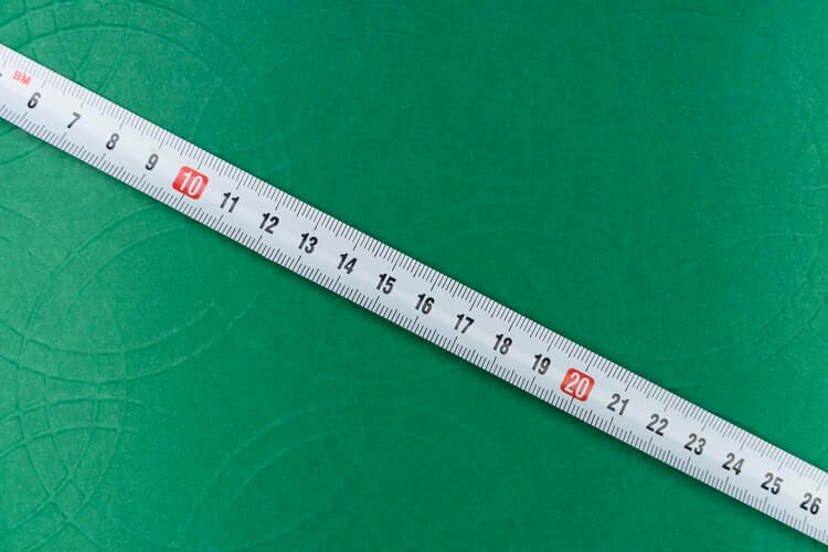 white ruler on a green background